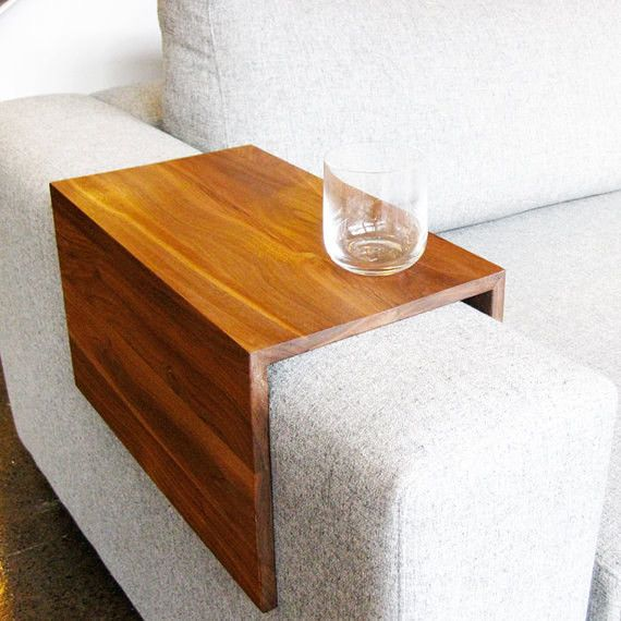 """Get rid of your end table and use this <a href=""""https://www.etsy.com/listing/102048420/the-original-couch-arm-wrap-solid-wood"""" target=""""_blank"""">sofa arm stand</a> instead."""