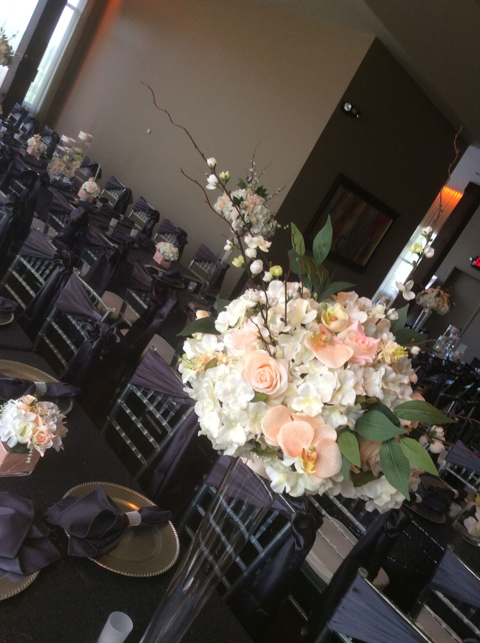 The flower centerpieces mini florals and candlescapes in hues of