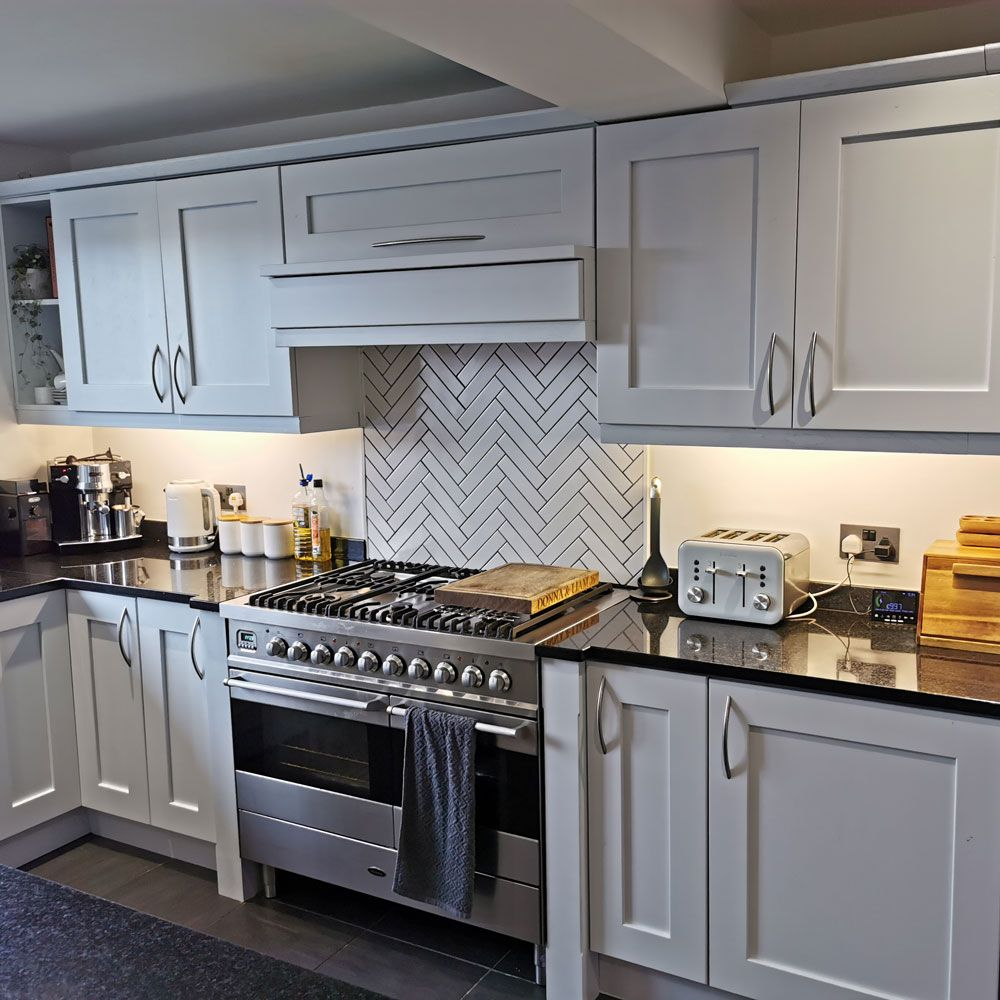 Grey spray-painted kitchen cabinets totally transform this ...