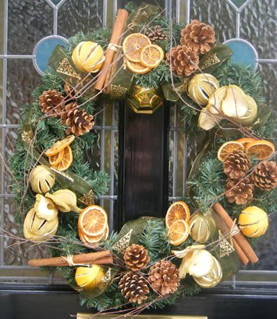A natural Christmas door wreath with dried limes, dried apple slices, cinnamon and orange.