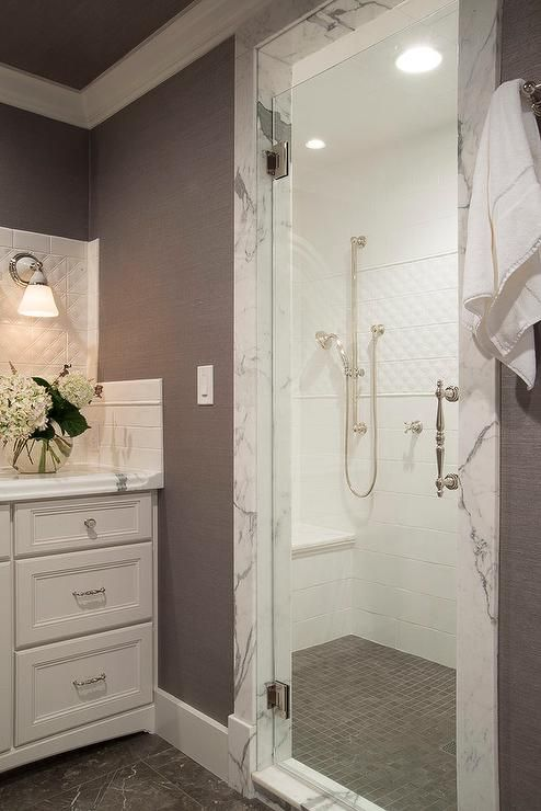 White And Gray Bathroom Features A Walk In Shower Filled With White