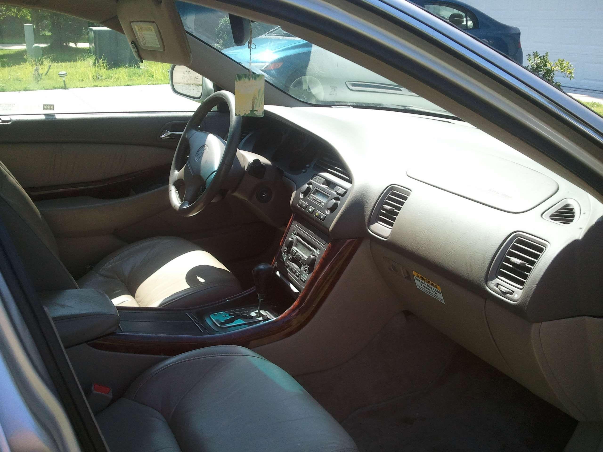 Make: Acura Model: TL Year: 1999 Exterior Color: Silver Interior Color: