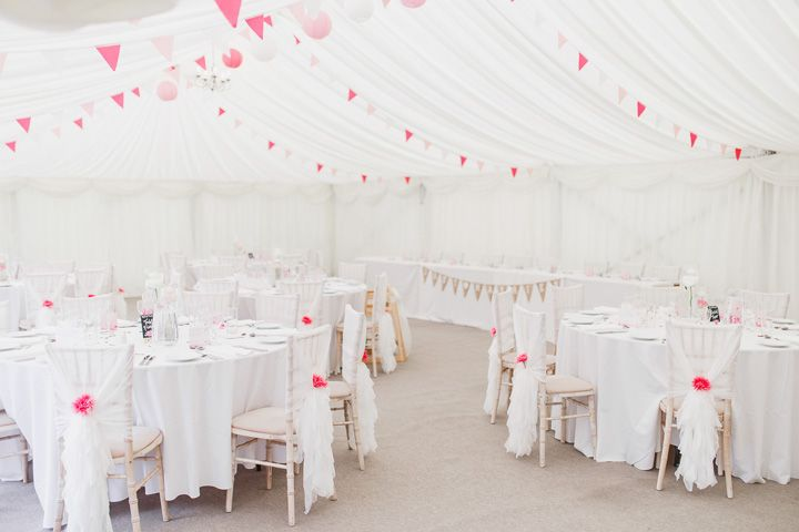Wedding reception decorated with pink buntings | soft pink and white fun spring wedding theme | fabmood.com #wedding #springwedding #funtheme