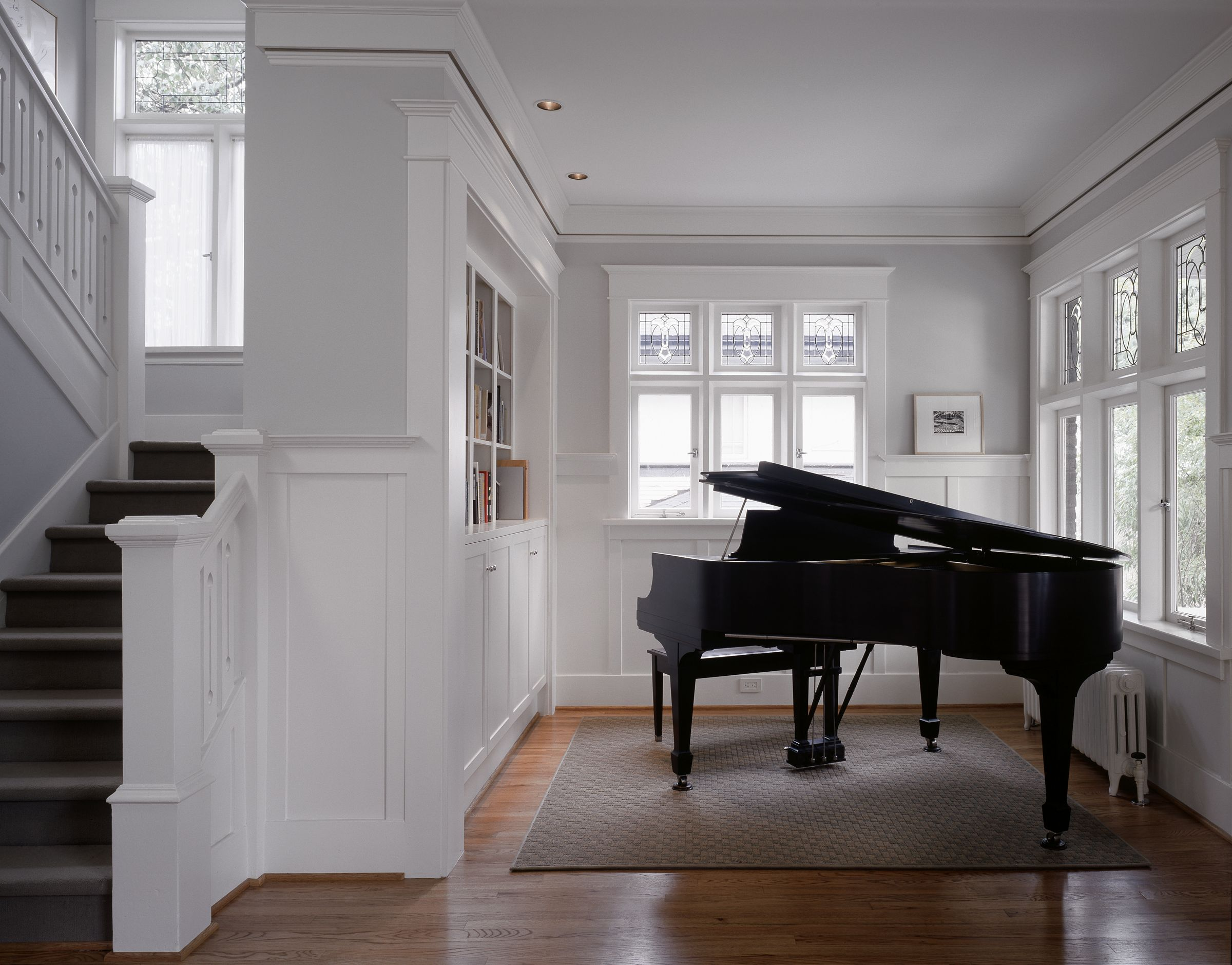 Removing a wall between the living room and a small parlor makes a