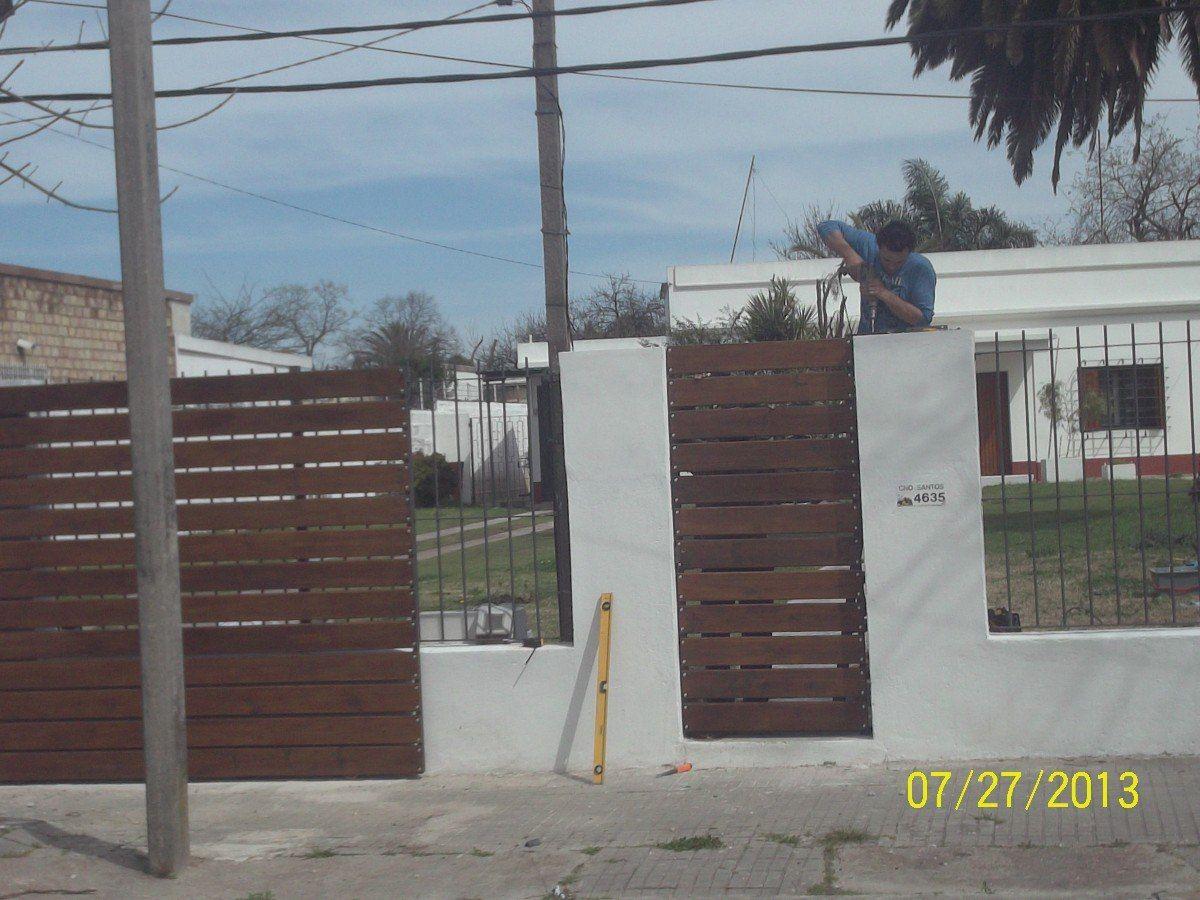 Portones hierro y madera 6243 mlu5041995169 092013 for Portones de hierro para garage