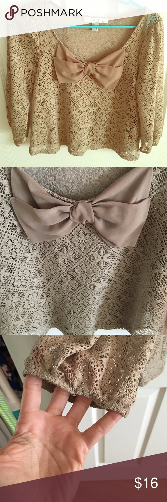 Quarter sleeve lace Bow blouse Quarter sleeve beige/taupe color lace blouse. Love the bow detailing! Sleeves are fitted at cuff. Slightly cropped. Lightly worn. No signs of wear Forever 21 Tops Blouses