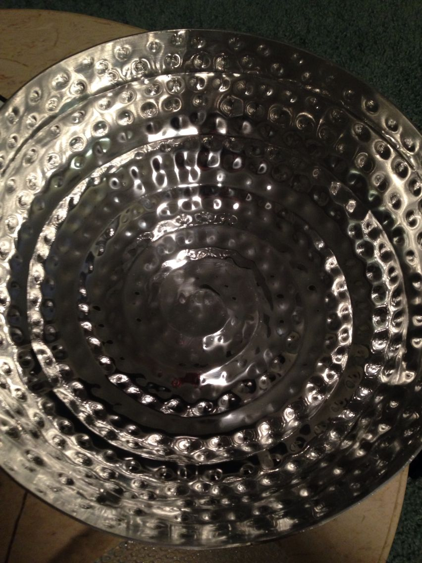 Large silver bowl that will hold mini water bottles at the ceremony. Love the swirled tentacle-like design.