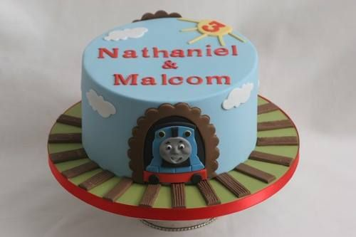 For Nathaniel and Malcom to celebrate their 3th birthday on Christmas Day. Inside: vanilla victoria sponge layered with chocolate buttercream. I hope they liked it! - http://ift.tt/1Q9cLnn