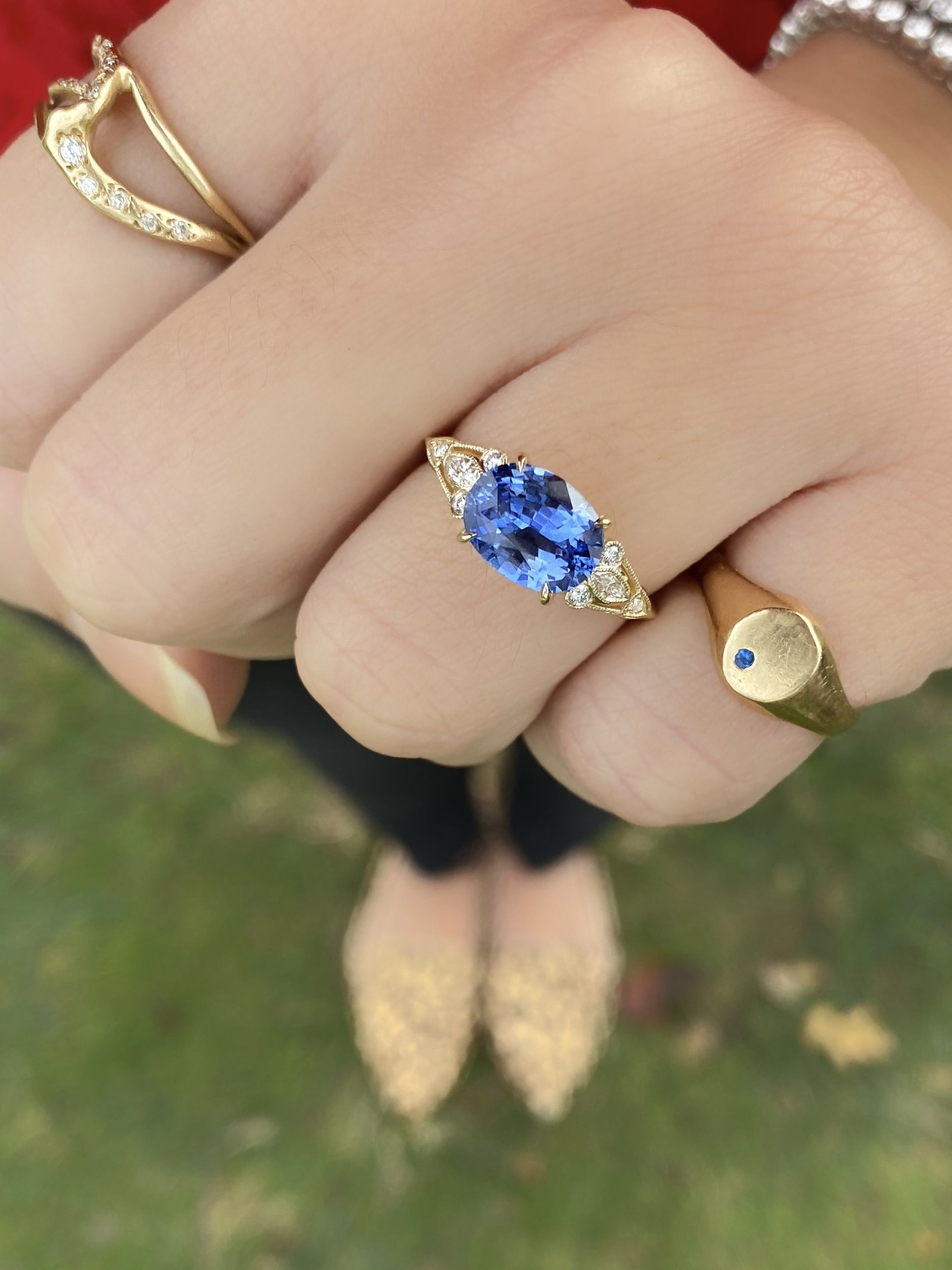 This wedding ring set is absolutely beautiful. The combination of yellow gold, diamonds, and a stunning sapphire is a classic and timeless look. This set also brings together the vintage look of Lippy and the unique nature inspired sculptural design of Razel. See these two rings in more detail on our website! #kenanddanadesign #customdesign #nycjeweler #weddingringset #vintageinspiredengagementring #diamondweddingringset #splitshank #vintageinspired #sapphire #ovalsapphire #sculptural #nature