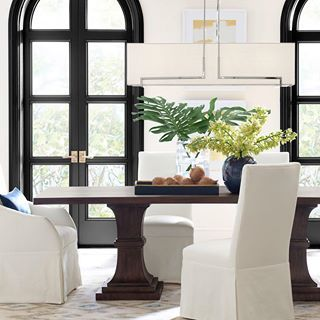 """Achieve """"tropical chic"""" with crisp white upholstery rich brown"""