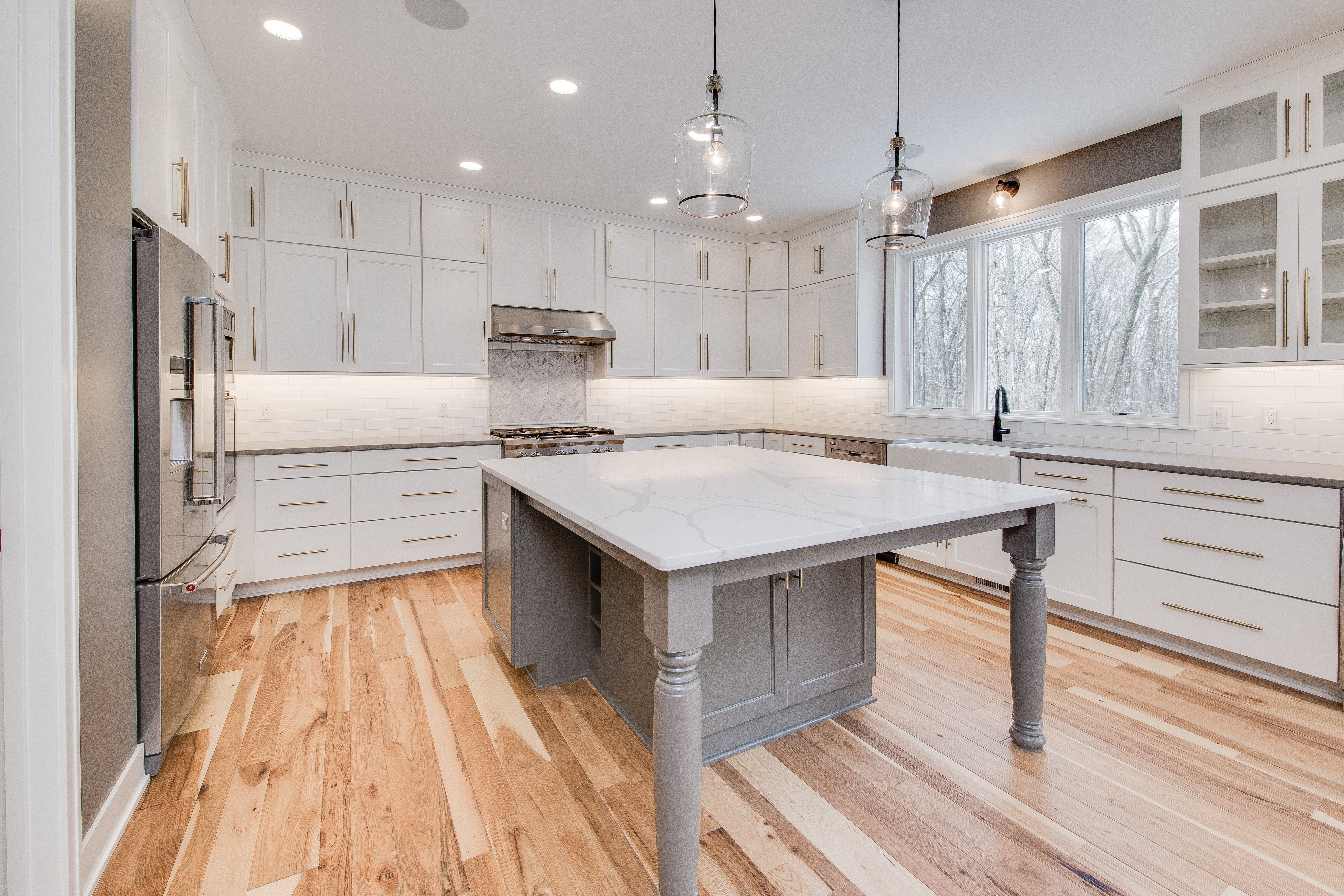 Kitchen Natural Hickory Hardwood Floors Contrasting Painted Island And Cabinets Natural Slate Count Hickory Flooring Country Kitchen Countertops Countertops