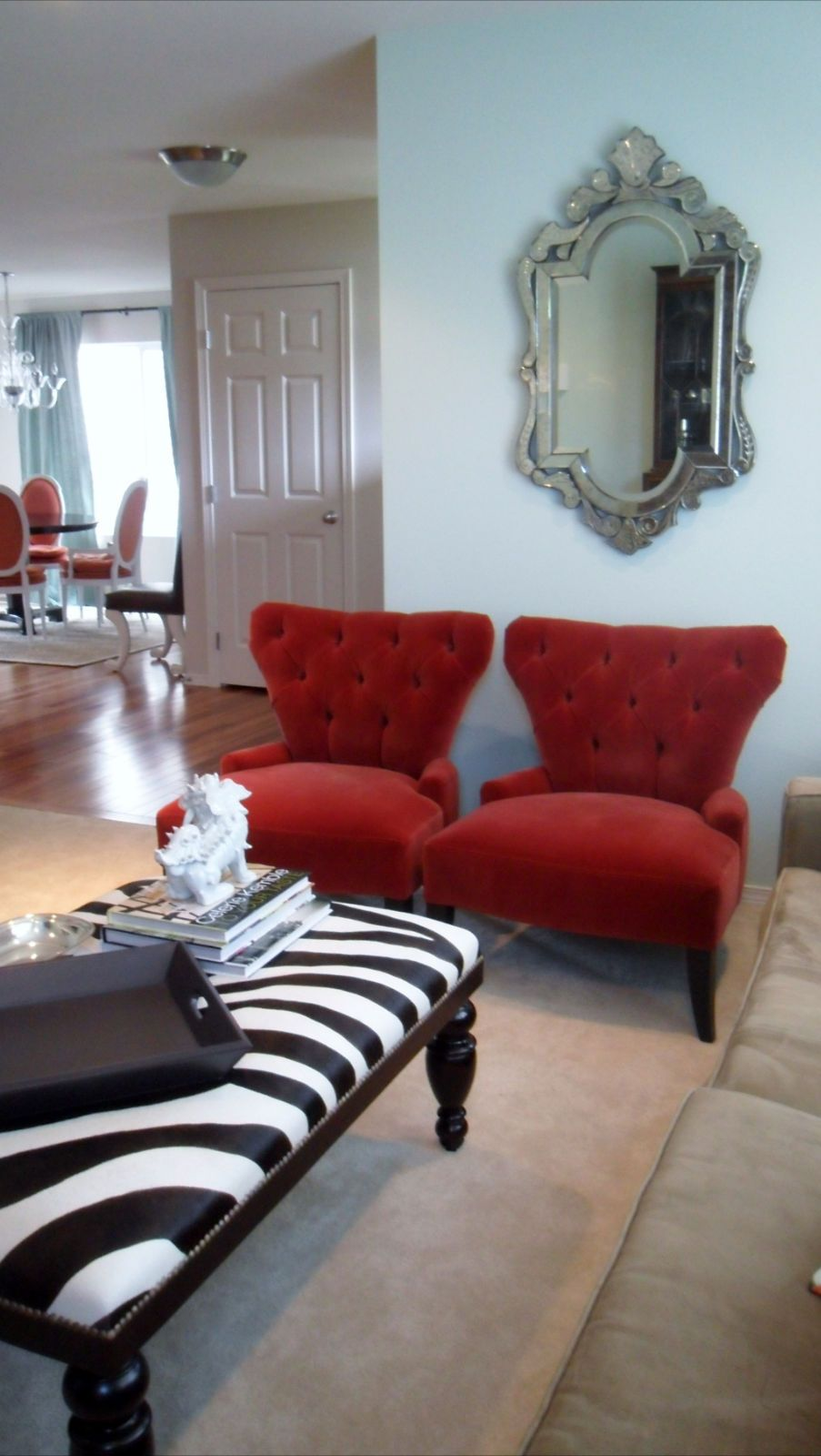 living room- love the zebra print and red accent chairs ...
