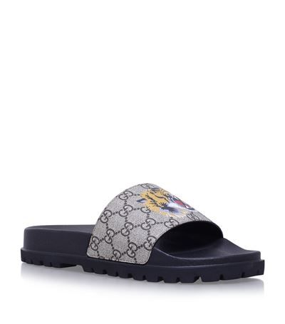 103f60d260ee9 GUCCI Pursuit Tiger Logo Printed Sliders.  gucci  shoes