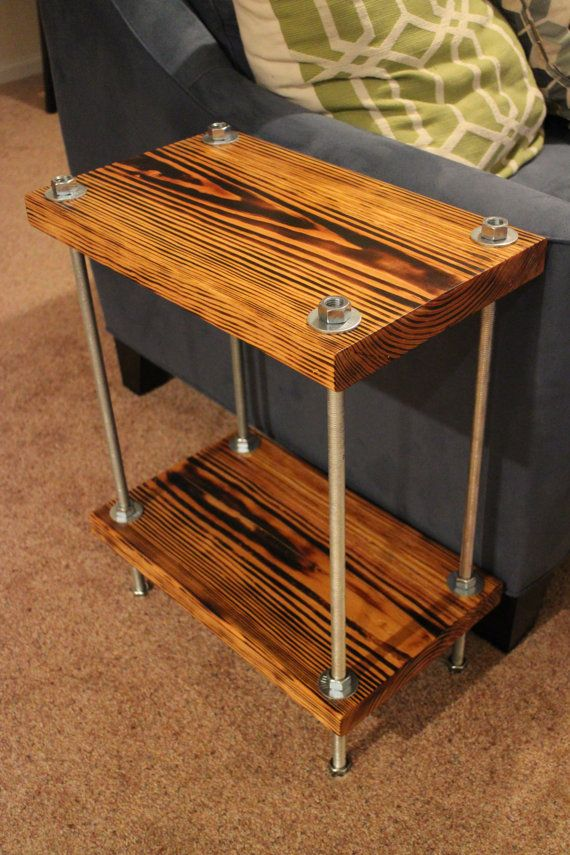 Burnt Pine Wood Table With Bold Industrial Threaded Rods Held