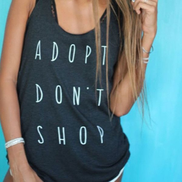 Adopt Don't Shop A trendy lightweight tank top designed with a round hem and casual racerback is what every wardrobe needs. From Clothing By OWL - Scoop neckline - Pullover style - Sleeveless - Racerb