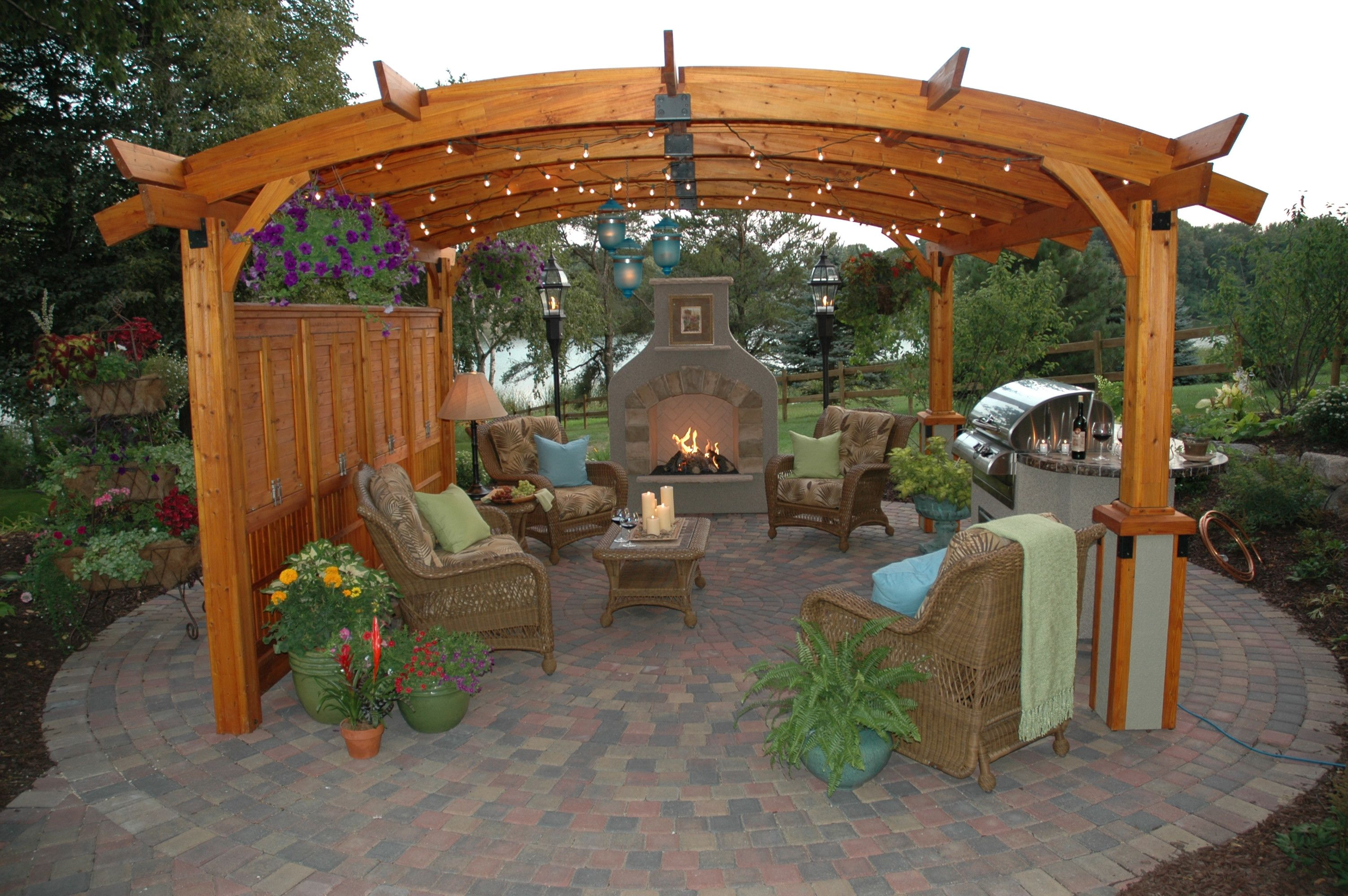 Outdoor Sitting Area With Fireplace Under Pergola Quite