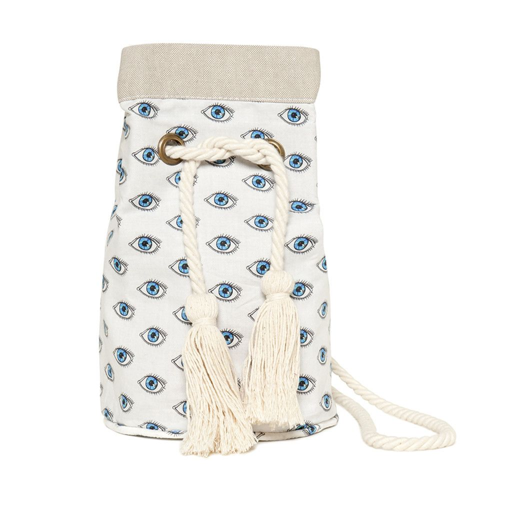 """The """"Beach Bucket"""" is our new morning to evening bucket bag, perfect for off-duty days, and relaxed nights-out. It is made of printed cotton fabric, lined with cotton canvas and has a soft rope strap. Although it is small, it's pretty spacious and can easily fit your phone, wallet as well as your notebook. Our all time classic """"Watch Out"""" bucket bag will add a touch of folklore to your summer style!"""