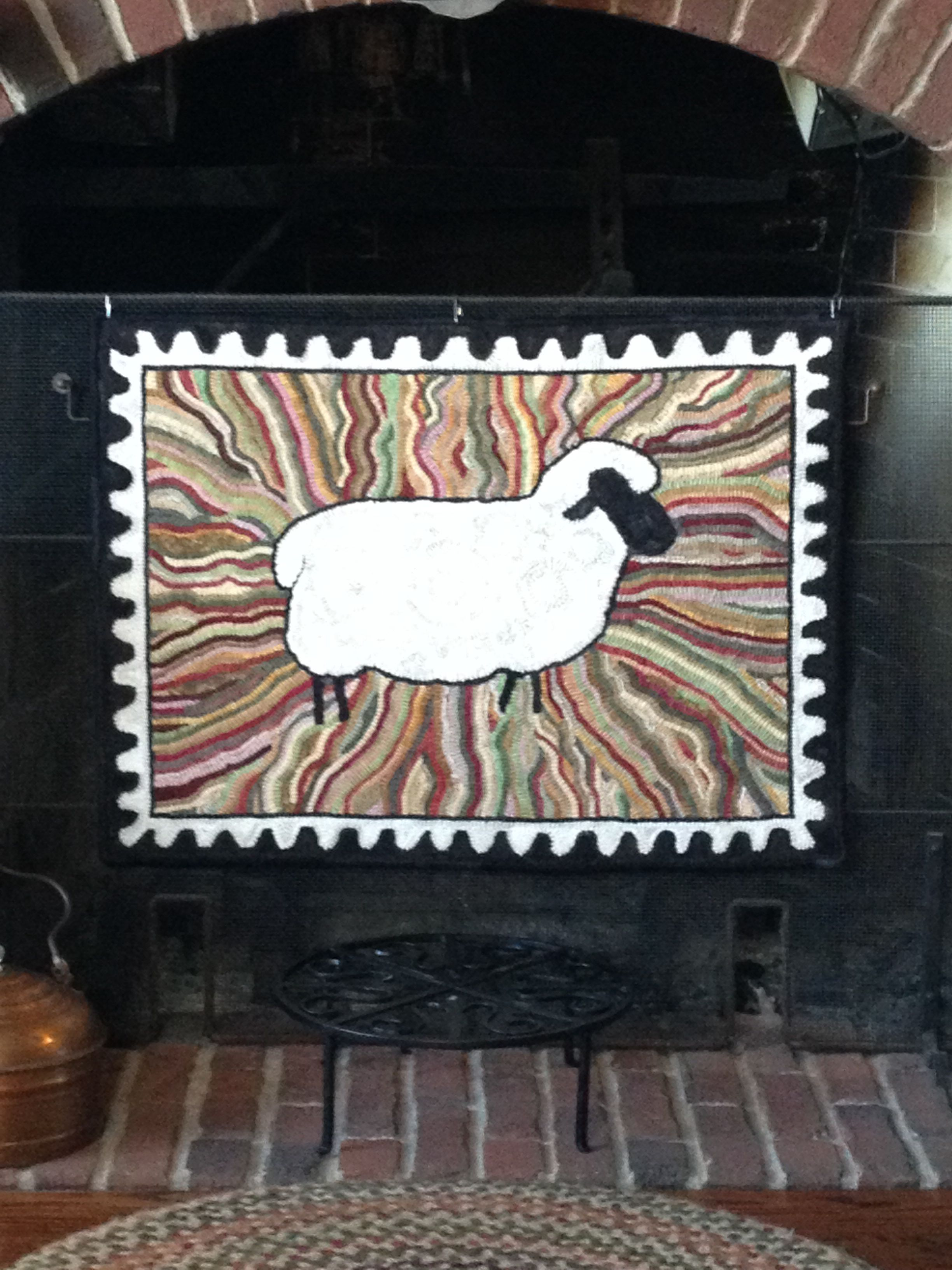 Sunburst Sheep designed and hooked by Wanda McCay.