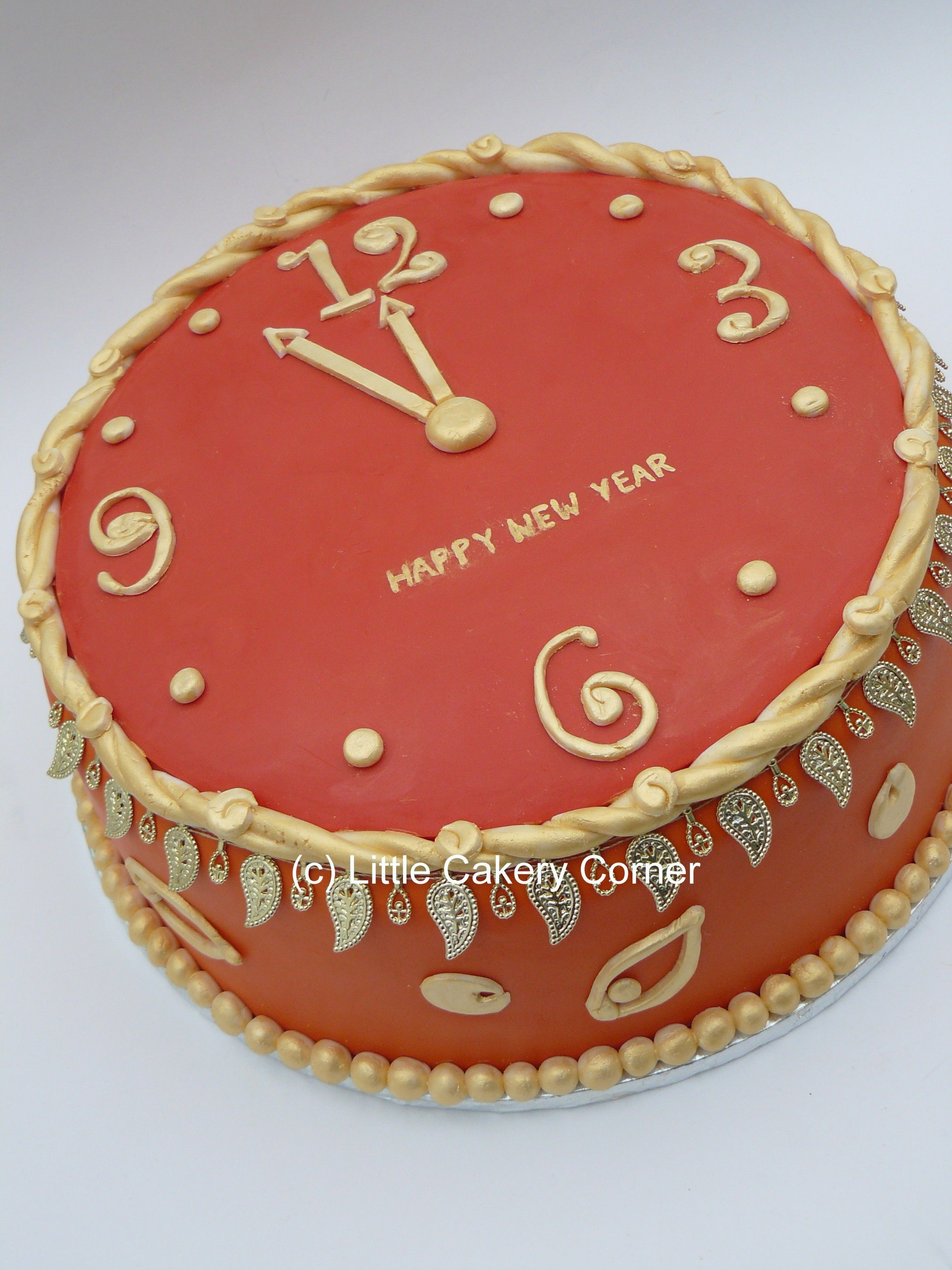 Happy New Year Cake This Orange Red And Gold Clock Cake