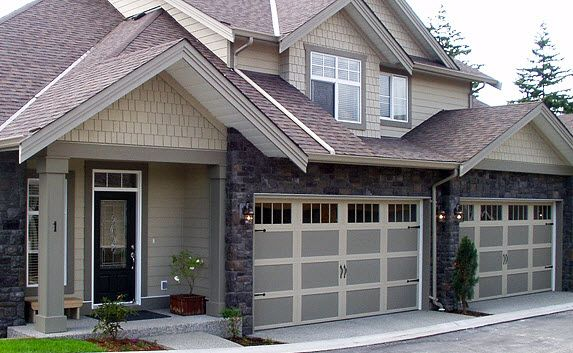 Craftsman Home Style With Steel Garage Doors That Have The Appearance Of Classic Swing Out Barn D Garage Door Design Exterior Entry Doors Craftsman Style Homes