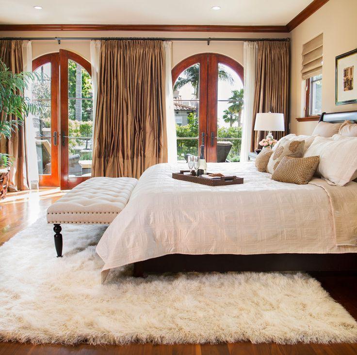 White-fluffy-rug-brown-master-bedroom-and-white-shag-rug