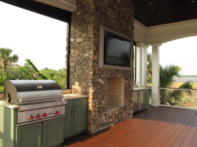 amazing covered deck patio with brick outdoor fireplace flatscreen tv outdoor fridge sink on outdoor kitchen on deck id=82657