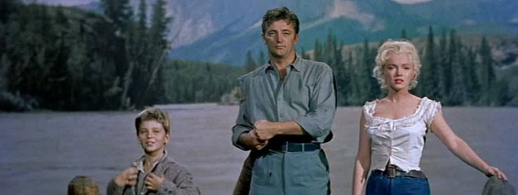 """Robert Mitchum, Marilyn Monroe, and Tommy Rettig in """"River of No Return"""" 1954."""