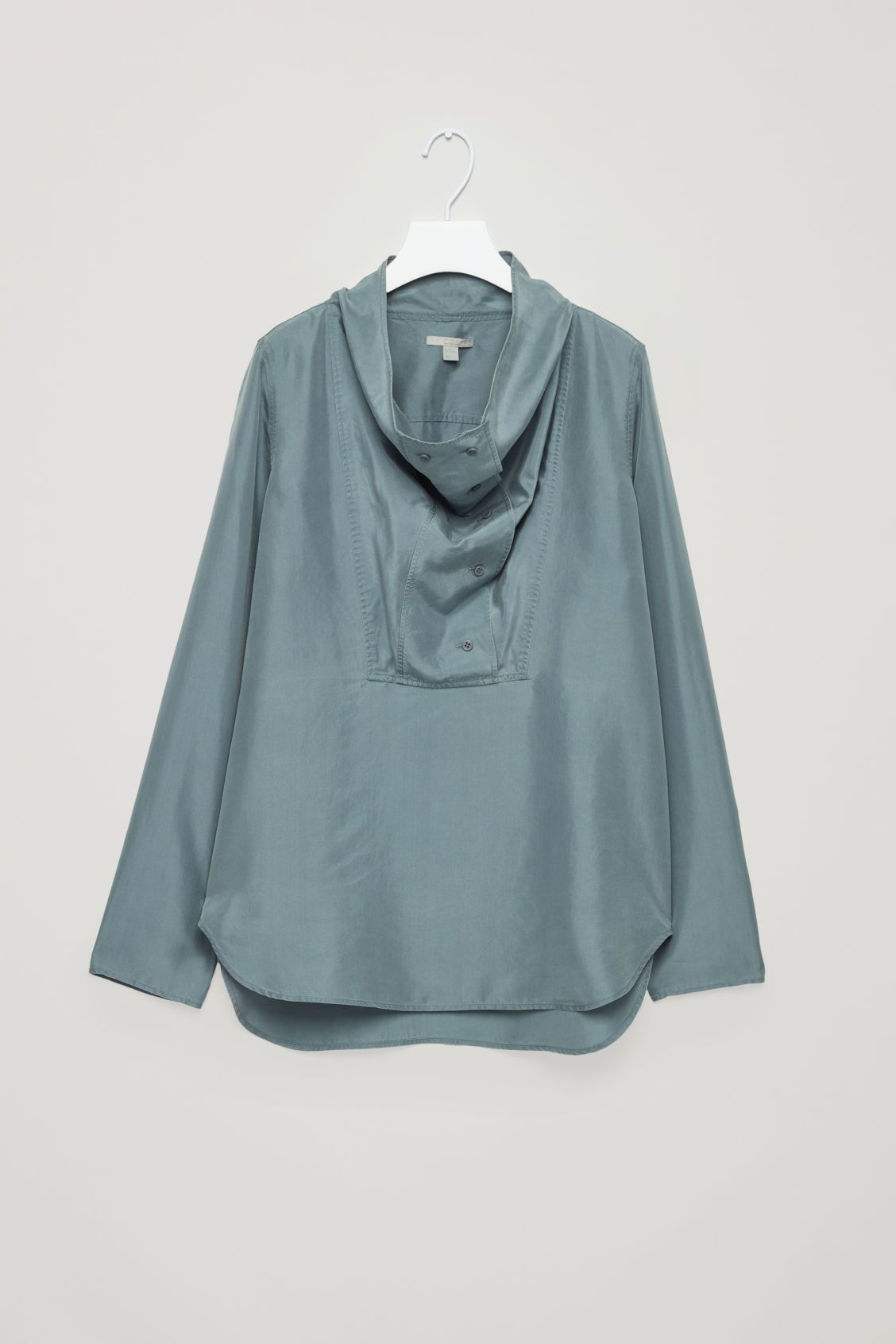 Cos green dress 2018  Front image of Cos silk shirt with draped neck in blue  Cos