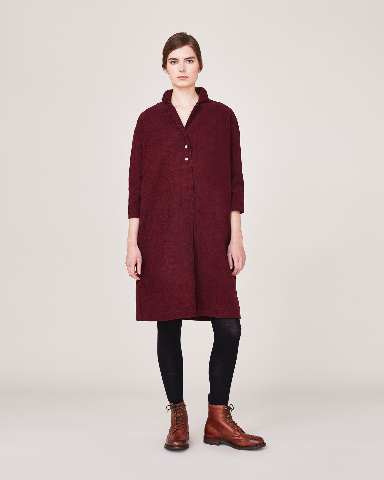 ELVIRE SHIRT DRESS Easy and slightly A-line pull-on shirt dress in soft, supple 11 wale corduroy. Soft collar and lapels with three corozo buttons to fasten. Just below-elbow length sleeves. Box pleat into back