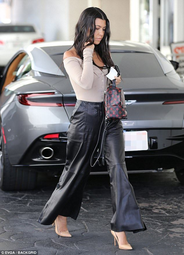 Kourtney Kardashian flashes flesh in low cut top and leather pants #dailymail
