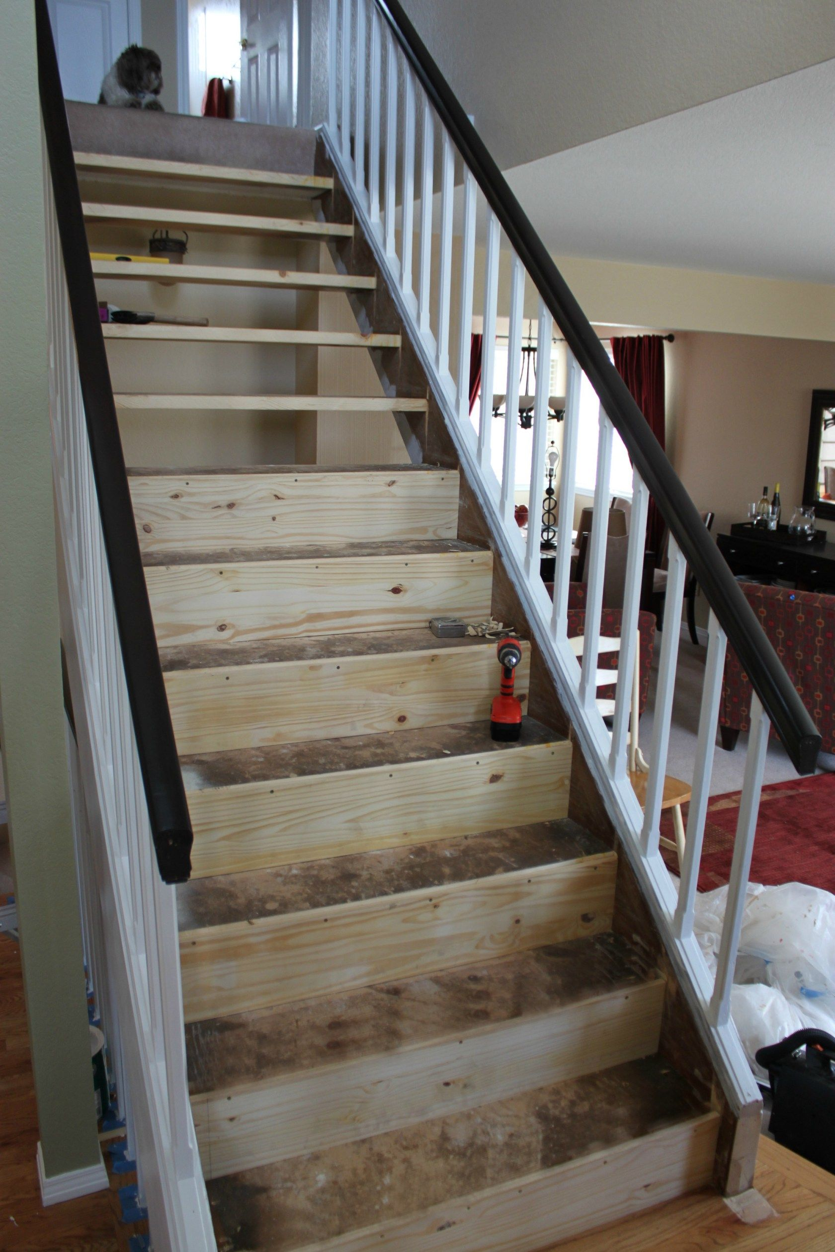 DIY Stairway Makeover. Open Tread Stairway Remodel Before And After. I  Closed In The Open Tread Stairs With Dark Oak Treads And White Risers.