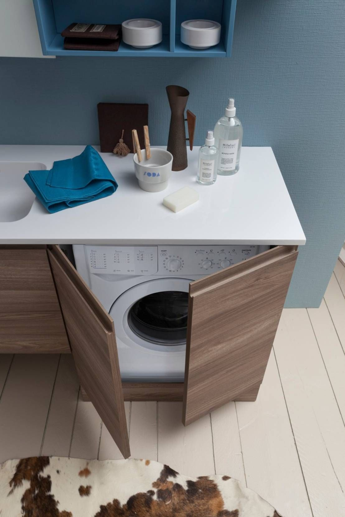 A nice way to hide the washing machine if you don't have a dedicated laundry, is in a cupboard.