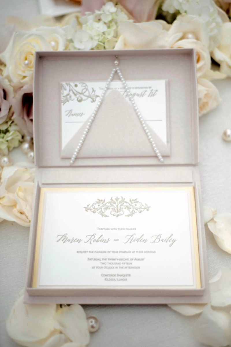 Luxury letterpress boxed invitations in blush and gold