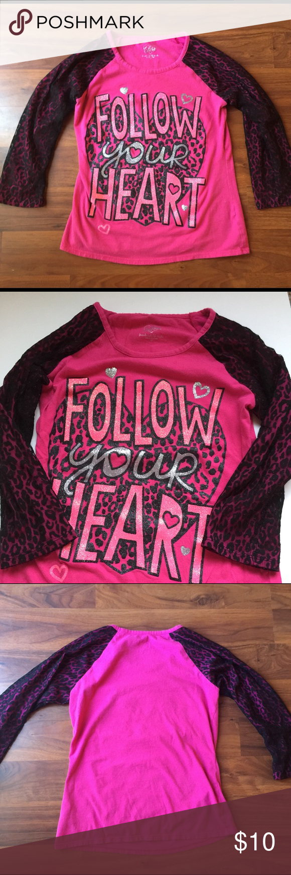 """Justice Top Super cute pink 3/4 sleeved shirt. Says """"Follow your heart"""" on the front. Sleeves have a cheetah print lace design. Other than normal wear from wash, no flaws. Justice Shirts & Tops"""