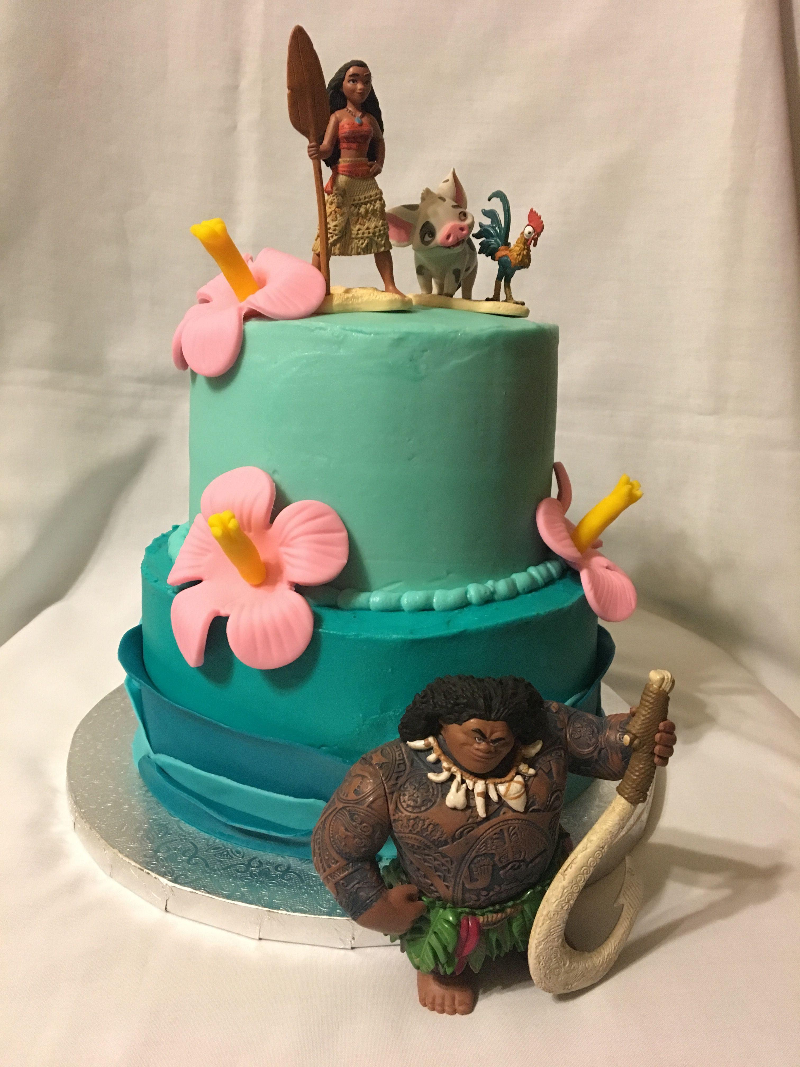2 tier Moana cake with fondant flowers and ruffle waves