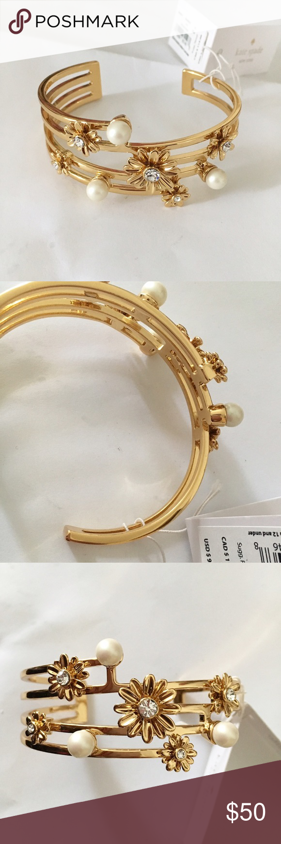 Kate Spade New York Pearl Daisy Cuff This gold cuff from Kate Spade has multiple rows with stacked daisies with gems inside as well as faux pearls. Comes with gift bag/box. kate spade Jewelry Bracelets