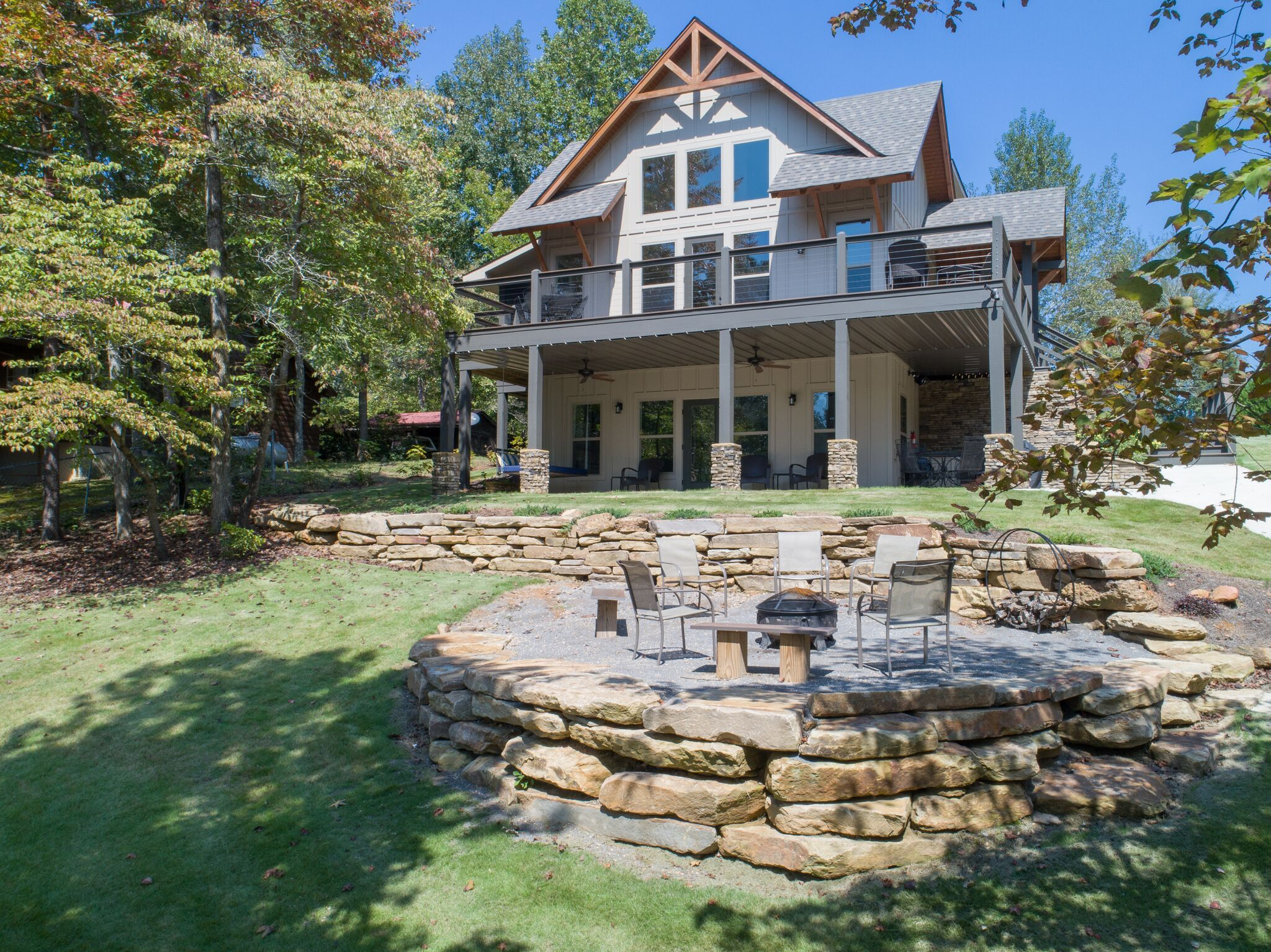 Beautifully crafted lake house with a large porch and a