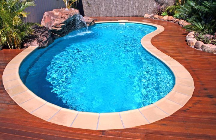 Small Kidney Shape Pool With Wooden Deck Swimming Pool Decks Kidney Shaped Pool Backyard Pool