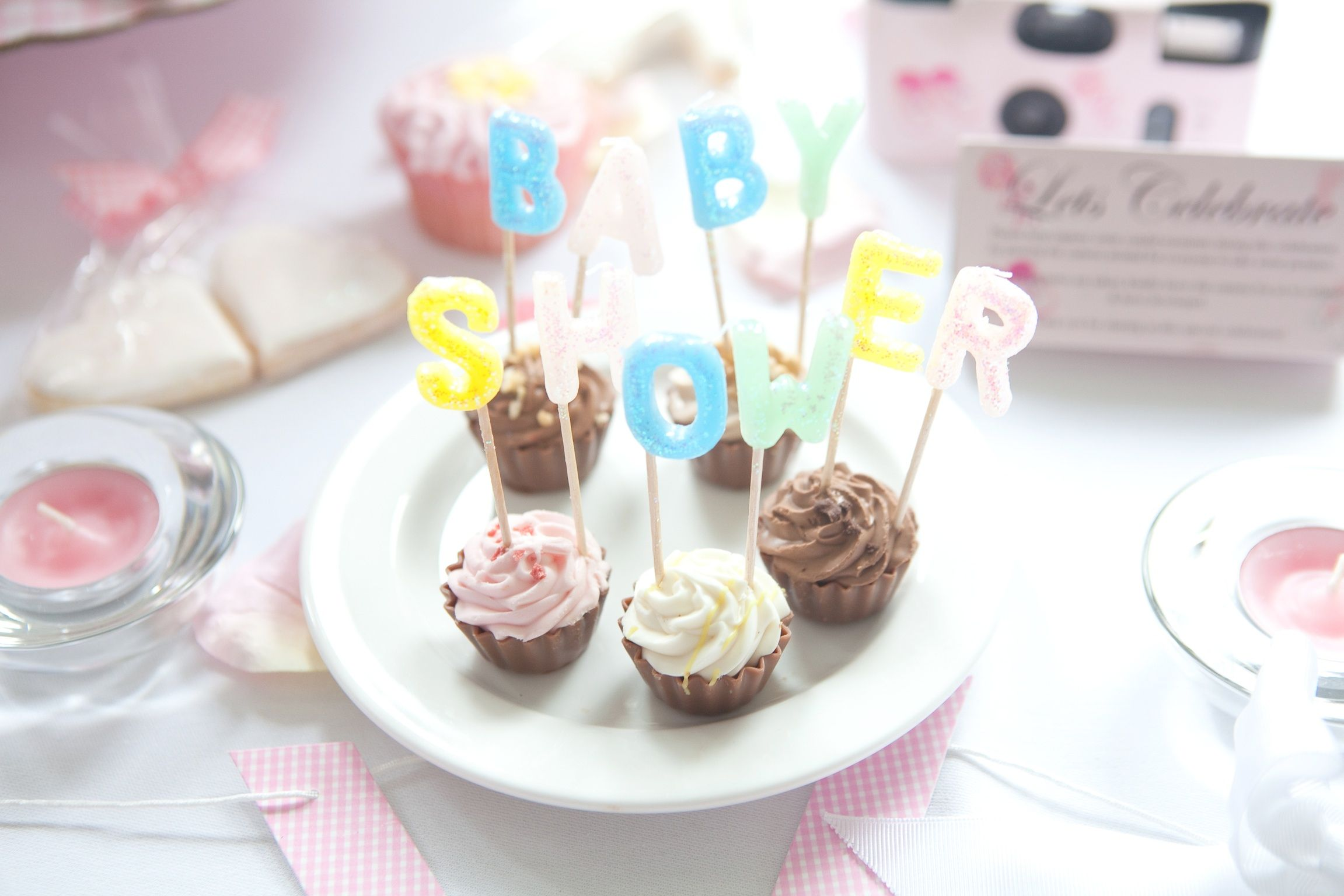 Cute cupcake flavoured chocolates with baby shower candles make a