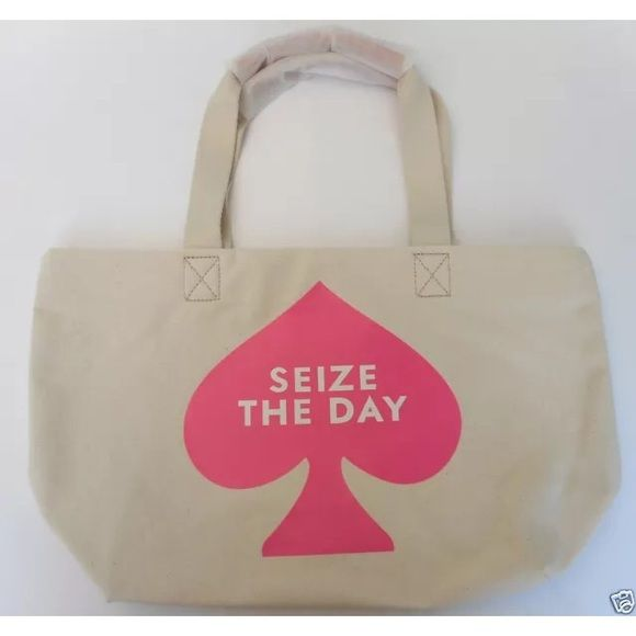"Kate Spade ""Seize the Day"" Canvas Tote 18"" Bag Kate Spade ""Seize the Day"" Canvas Tote 18"" Bag  Never used, new item with tags.  Handle protector still attached. Beautiful limited edition Kate Spade New York Seize The Day cotton canvas tote bag.  Perfect for the around town or a day at the beach.  Hand wash.  Imported.  18""W x 11""H x 6""D kate spade Bags Totes"