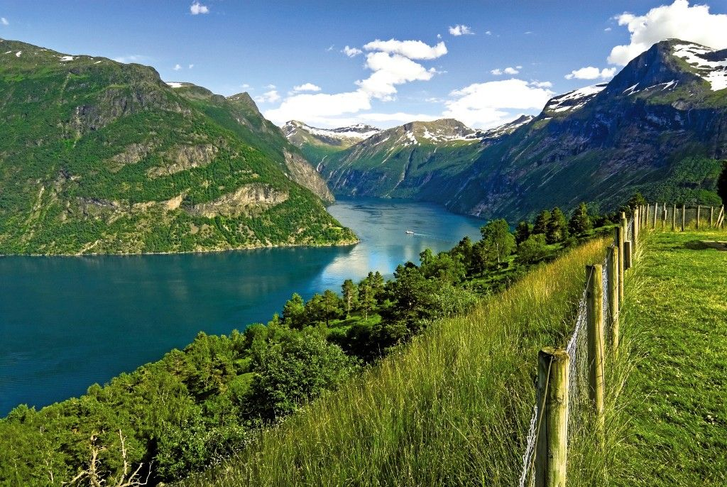 With is snow topped peaks and steep green slopes, the Fjords are a truly beautiful place to visit.