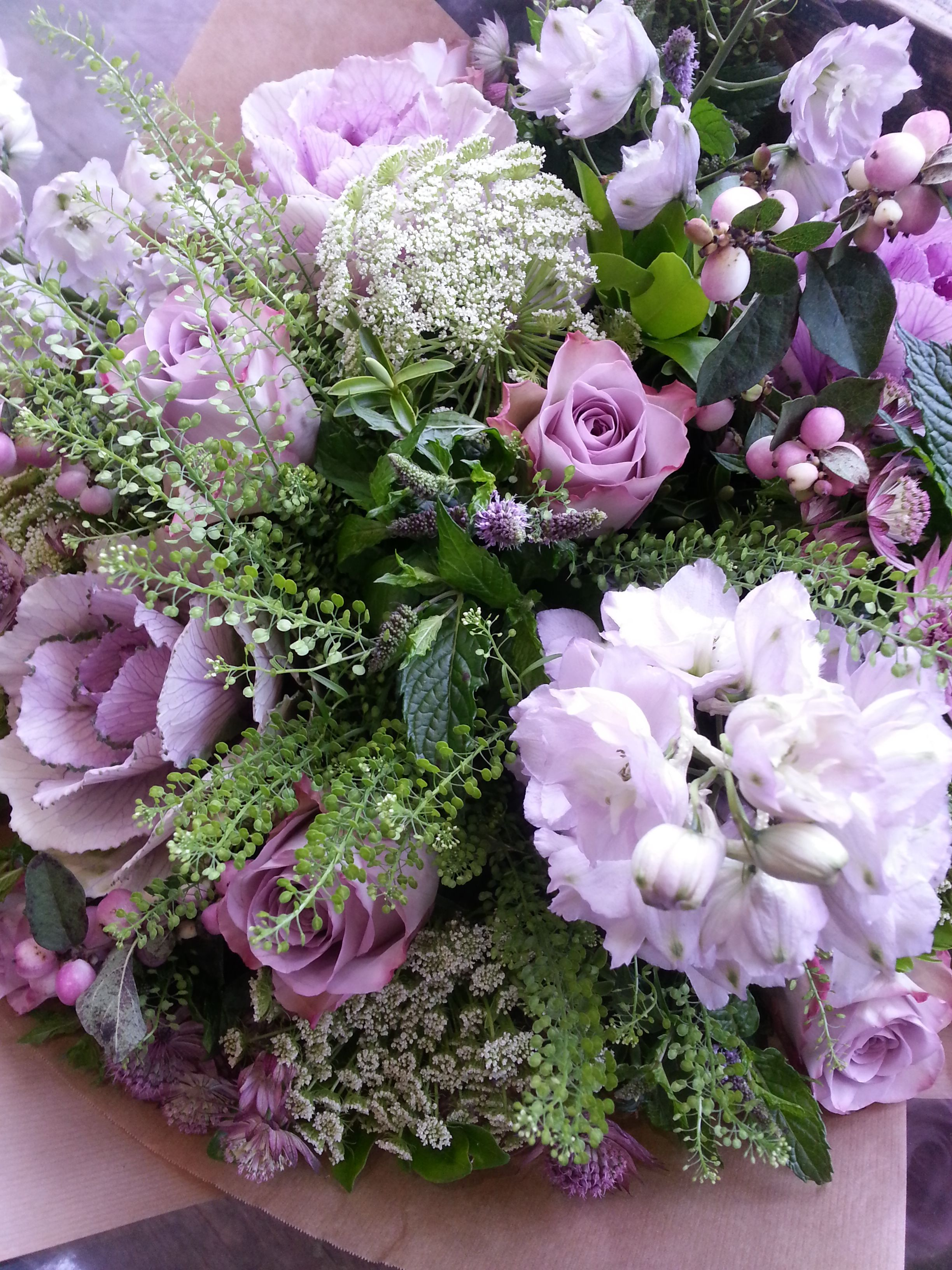 cabbages, memory lane roses, delphiniums, ammi and snowberries made