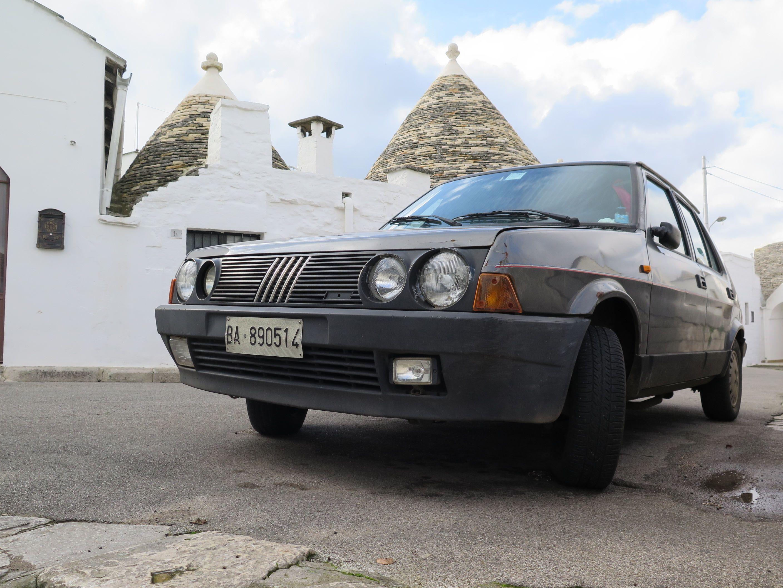 Rusty Fiat Ritmo found hidden in between the stunning Trulli's in Alberobello.