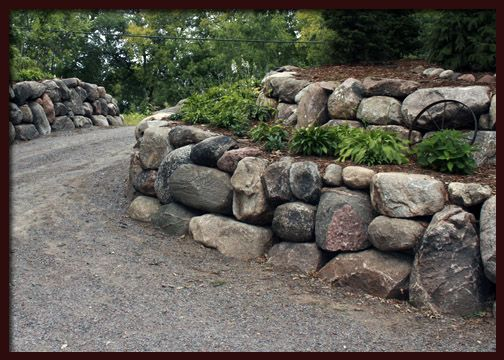Rock Wall Along Curved Driveway Landscaping With Rocks Rock Retaining Wall Driveway Landscaping