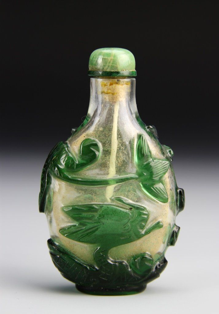 A green glass snuff bottle with dragon