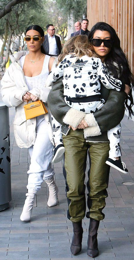 983a5e57a635 Super cute photo of Kourtney   Kim Kardashian with Penelope wearing an Adidas  Original Mini Rodini Panda Track Suit. I want one of these!!!