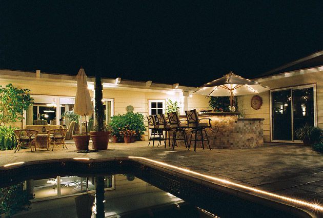 Low Voltage Outdoor Lighting Crates A Dramatic Border Around Swimming Pool While Offering Additional Safety