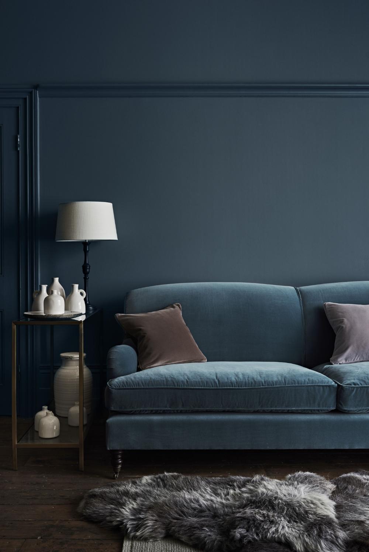 petrol blue velvet sofa in a navy blue room Google