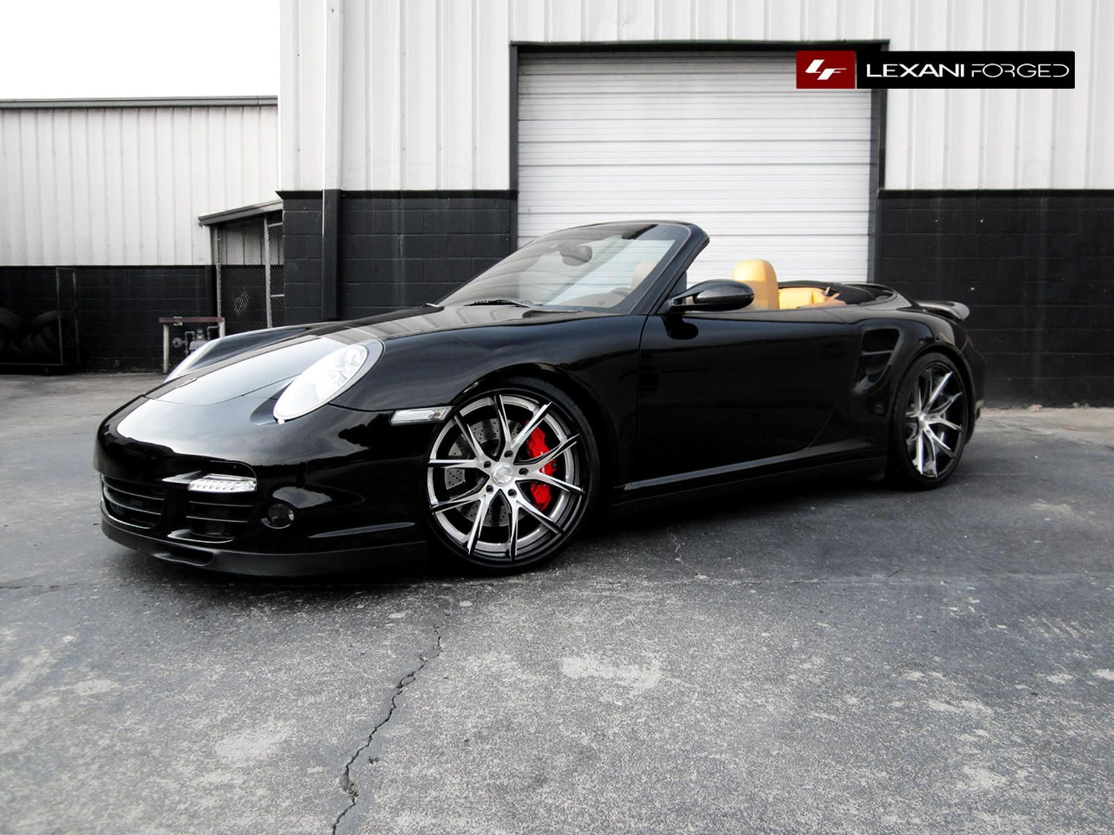 2013 black porsche turbo in black inner with a brushed and