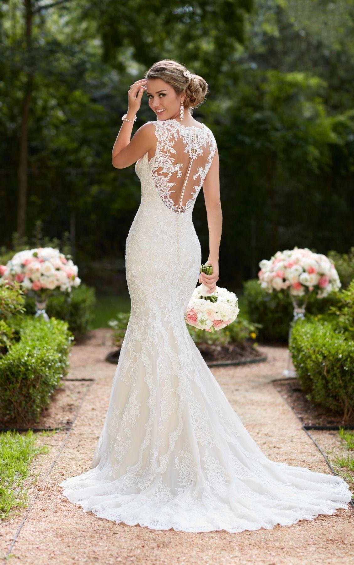 This vintage lace trumpet wedding dress by Stella York